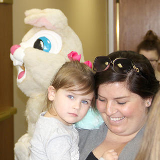 The Easter bunny made an appearance at the Cynthiana Christian Church.  Millie Ashbrook preferred the comfort of her mom, Laura, to the Easter Bunny,