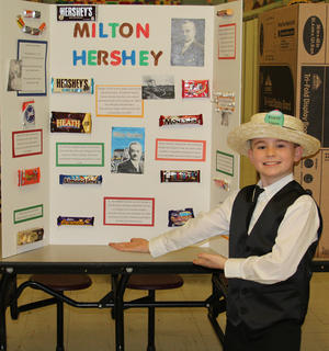 Fourth grade students at Northside Elementary School presented a wax museum on Thursday, Feb. 23. Students selected historical figures, researched that figure, created a visual display and became that character. The figure chosen had to be a US citizen, deceased, and had an impact on society.  Daniel Bowlin researched his historical figure on Milton Hershey.