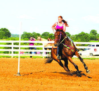 Brooke Frederick competed in the Youth Poles Race at the Harrison County Fair Fun Horse Show.
