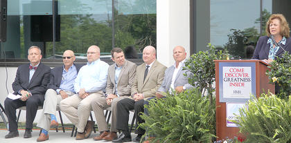 HMH CEO Sheila Currans gave opening remarks during Friday's grand reopening. Seated, from the left Dr. Stephen Bessen, HMH Board member; former Board member Doug Hampton; past chairman of the board, Dr. Brian Mulberry; Sen. Steve West; Rep. Mark Hart; chairman of the board, Steve Judy.