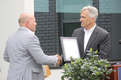 Purgenix CEO Sam Perkins presents Board Chairman Steve Judy with a plaque identifying HMH as the first hospital in the US as a PurHospital.