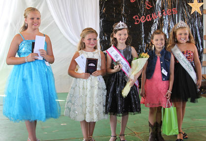 From left, Mallory Creech receiving second runner-up, Gabby Florence first runner-up and best dressed, Demi Lemons Miss Junior Pre-Teen, Destinei Hutchison awarded with the prettiest smile, and 2013 Miss Junior Pre-Teen Alexis Wright.