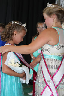 Briana Tucker, daughter of Travis and Kacey Tucker was crowned Miss Junior Pre-Teen by Gabby Florence, 2015 Miss Junior Pre-Teen.