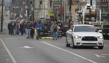 Photos by Lee Kendall  Around 50 people of all races and ages participated in the annual Martin Luther King Jr. march in downtown Cynthiana. This year's march was held on Monday, Jan. 16, one day after Dr. King's actual birthday. The march began at Ebenezer United Methodist Church, wound through downtown Cynthiana and ended at Macedonia Baptist Church. Following the march, a special service honoring Dr. King was held at Macedonia, followed by a meal.