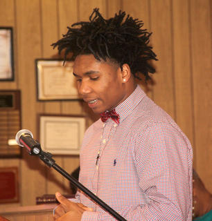 HCHS senior Malcolm Walker read a poem about Dr. King during the ceremony.
