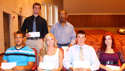 NAACP Scholarship. Seniors who received the NAACP scholarship were: front row, from left, Dominic Walker, Ally Barnett, John Embry Vanhook, Hailey Jones; back row, Dillon Pulliam and presenter Kenneth Newby.