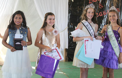 From left, Sarah Allison was second runner-up, Lillie Cook first runner-up and best dressed, Miss Pre-Teen Anna Midden, also received the prettiest smile award, and 2013 Miss Pre-Teen Victoria Gasser.
