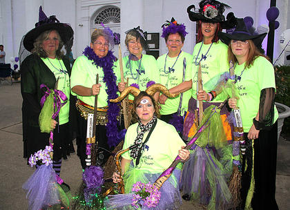 Witcher was afoot on  Friday as the witches put a curse on cancer with their dance to the Purple People Easter. Witches are: kneeling, Lourena Judy (the one-eyed, two-horned purple people eater); standing from left, Paula Haviland, Luanne Wilson, Kathi Patrick, Kathy Brown, Kristin Church and Bethann Thomas.