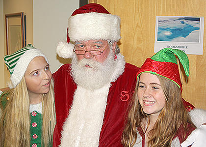 Santa's helpers, Jingle and Jangle, were on hand at the Library.