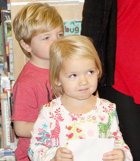 This brother and sister spied Santa as he entered the library to visit with the children.
