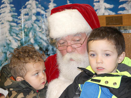 These two were a little skeptical about sitting on Santa's lap, at first, but they eventually shared their Christmas wishes with him.