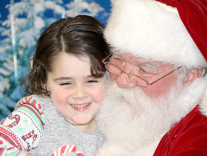This little cutie  felt right at home discussing her wish list with Santa>