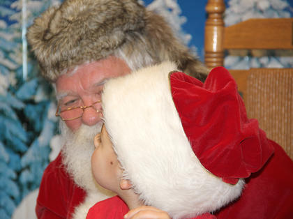An ancestor of Daniel Boone swapped his coonskin cap with Santa for a time at the library.
