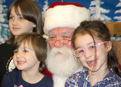 "One of them said something to Santa about maybe wanting her ""two front teeth"" for Christmas!"