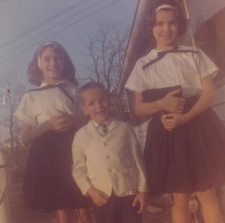 Photo submitted by Loretta Fryman Rhonda Fryman (Moore), Vicki Fryman (Whitaker) and Yancy Steven Fryman going to church. They are the children of Erman (Joe) and Loretta (Fite) Fryman and the grandchildren of the late Yancy Fite and Mary Lyons Fite. Photo taken in 1964.