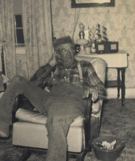 Photo submitted by Loretta Fryman Yancy Fite, 1957, enjoying his new chair. Notice the old spittoon beside him.