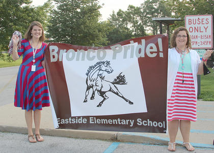 Amanda Phillips, left, and Ruth Tutewiler took part, along with other teachers and school personnel, to welcome students back to Eastside Elementary.