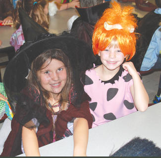 Second graders Hannah Mitts as Gritch the Witch and Kaitlin Lewis going old school Hanna-Barbera in her Pebbles Flintstone costume