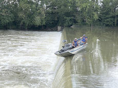 """<div class=""""source""""></div><div class=""""image-desc"""">Benjamin Creech and Charles Flora, both of Lexington, were fishing the South Fork of the Licking River on Sunday afternoon, when they got hung up above the A. Keller dam. The outboard motor on their Bass Tracker kept them from going over the dam. They were rescued by members of the city and county fire departments.</div><div class=""""buy-pic""""></div>"""