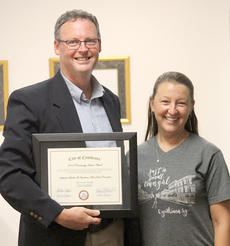 "<div class=""source""></div><div class=""image-desc"">Cynthiana Mayor James Smith presents the city's second Community Impact Award to Stephanie Buirden, director of the Cynthiana Main Street Program and her board of directors at Tuesday's Cynthiana City Commission meeting.</div><div class=""buy-pic""><a href=""/photo_select/46879"">Buy this photo</a></div>"