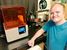 "<div class=""source""></div><div class=""image-desc"">Elliot Rognstad shows the 3D printer used to create a new pill tray.</div><div class=""buy-pic""></div>"