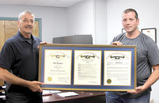 """<div class=""""source"""">Becky Barnes</div><div class=""""image-desc"""">Cynthiana Police Chief Ray Johnson, left, presented a Kentucky State Police citation to Ptl. Jeff Thomas, an eight-year veteran officer of the CPD. Thomas was honored for meritorious service in the assistance of Kentucky State Police troopers to rescue a Cynthiana woman who had jumped from the West Pleasant Street bridge last summer.</div><div class=""""buy-pic""""><a href=""""/photo_select/41653"""">Buy this photo</a></div>"""
