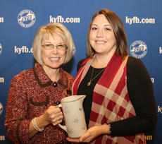 """<div class=""""source""""></div><div class=""""image-desc"""">Kayleigh Evans, right, of the Harrison County Farm Bureau Women's Committee, accepts the 2017 Gold Star Award of Excellence from Vicki Bryant, chair of the Kentucky Farm Bureau state Women's Committee. The award was presented during a Dec. 1 recognition program at the 98th Kentucky Farm Bureau annual meeting.</div><div class=""""buy-pic""""></div>"""