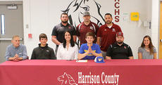 """<div class=""""source"""">Donald Richie</div><div class=""""image-desc"""">Harrison County High School senior Brent Hudgins, front, row, center, signed to wrestle at Midway University in a ceremony last Friday. With him were, from left, his grandfather Mike Hudgins, his brother Tyler, his mother Alyssa, his father Andy, his sister, Kylie; back row, HCHS head wrestling coach Josh Ashbrook, Benji French, HCHS assistant wrestling coach Daniel Martin.</div><div class=""""buy-pic""""></div>"""