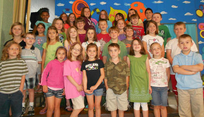 Reading Awards. Front row, from left, Iziah Cole, Zoe Sexton, Haleigh Sharp, Ashlynn McNees, Asher Harrington, Lily Moses, Rilee Wright, Zachary Hanson; second row, Evey Barker, Alex Adams, Kaley Robinson, Sera Laney, Riley Moses, Charlie Furnish, Ryan Lawrence, Rachel Clifford, Sean Cochran; third row, Hope Stiltner, Olivia Tucker, Leah Kiskaden, Andrew Nickerson, Kenley Tumey, Keith Kinney, Ryan Cochran; fourth row, Sierra Black, Miranda Barnes, Sierra Eckler, Jima Hill, Miracle Switzer, Bailey Lawrence, Alexys Switzer, Isaiah Stiltner.