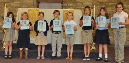 Catholic Schools Week Essay Contest Winners. Second place winners in the Catholic Schools Week Essay contest were: from left, Cecilia Boland, Abigail Rion, Skylar Hatfield, Jacob Hargett, Olivia Barry, Victoria Gasser, Seaanna Skinner, Lucy Barry.
