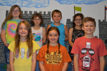 Kids' College Scholarships and Soil Conservation Poster Winners. Front row, from left, Soil Conservation Poster winners Hailey Lizer, Bailee Lizer, Cameron Power; back row, Kid's College Scholarship Recipients Madalynn Martin, Samantha Silcox, Kendrick McElfresh, and Cheyenne Spates.