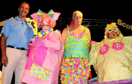 Winners of the 3M Post It Note Fashion Show were: Anthony Ecklar, representing 3M, served as head judge. Anna Mae Brooks in her pig outfit was second runner up, Larry White for Papa John's was the winner, and Lynne King with the Aqua Gals was first runner up.