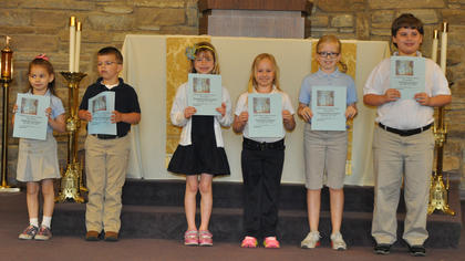 Catholic Schools Week Essay Contest Winners. First place winners in the Catholic Schools Week Essay contest were: from left, Kaitlin Barry, Jackson Payton, Meredith Fryman, Rachel Rion, Morgan Cooper and Eli Hargett.