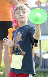 Pictured is Evan Copes, 9,  as he enjoys a game of catch with Velcro mitts. Copes was one of the 131 kids that beat the heat and participated in HMH Longest Day of Play.