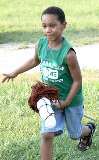 Tayvone Williams, 8, looks to beat his competition in the stick horse races.