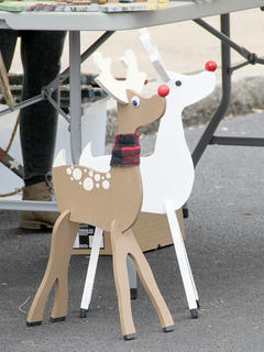 Hand-made wooden reindeer were a hit among the children in attendance.
