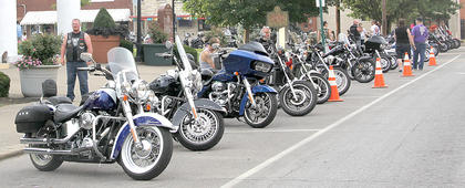 Motorcycles of all makes and models lined Pike and Main streets.