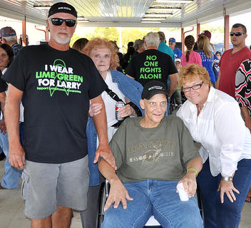 A benefit was held for Blue Grass Energy lineman Larry Lovelace on Saturday, Sept. 28, at  Flat Run Veterans' Park. Lovelace has been battling a very aggressive form of lymphoma cancer. Top left, Larry visited BGE last week.