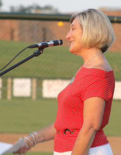 Carol Hyatt sang a medley of armed forces hymns.