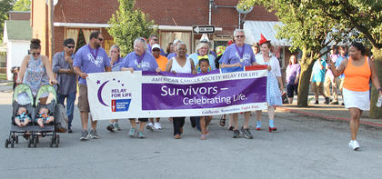 """Photos by Becky Barnes and Lee Kendall The 21st annual Harrison County Relay for Life was held on Main Street, by the Courthouse square on Saturday, June 16.  The Cynthiana Christian Church hosted a special """"Survivor Reception"""" to kick off the evening's festivities. There was a line dancing performance, special music by Jamie Eubanks, a jazzercize demonstration, a survivor's lap and a well-received skit by the HarriCyn Witches with a 'Wizard of Oz' theme. This year's monetary goal was reached, and then some. According to co-chair Paula Taylor Haviland, the goal was $35,000. """"We have counted just over $39,000, so far, and there is still some money coming in,"""" she said. """"I think we will be well over $40,000 when all is said and done."""""""