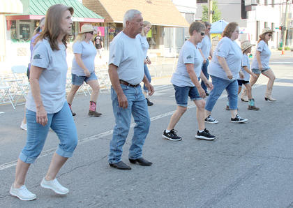Line dancing was performed by the local Boot Stompers.