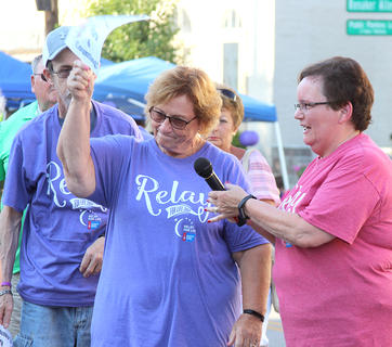 Kathy Brown, right, recognizes Patty Adams Hannah at Saturday's Relay For Life. Hannah was one of the originators of the Harrison County Relay For Life.