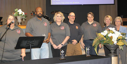 E-911 dispatchers were honored as Public Safety Professionals of the Year. From the left, Crickett Woods, Wilbur Gross, Brittany Adkins, Jay Sanders, LaDonna Brewer, Katie Tibbs and Lenora Kinney.