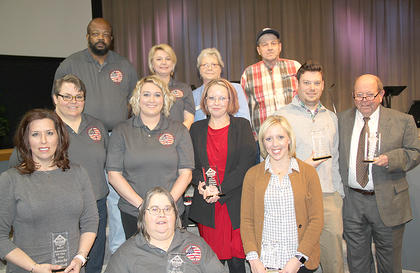 These are the  winners from Tuesday night's banquet. Seated is Crickett Woods from E-911; standing, from the left are Deanna Murdock, Educator of the Year; LaDonna Brewer, Wilbur Gross, Brittany Adkins and Katie Tibbs and Lenora Kinney, all E-911 dispatchers and recipients of the Public Safety award; Truly Pennington, Healthcare Professional of the Year; David Woods, Farmer of the Year, Mary Todd Ashbrook, Businessperson of the Year.
