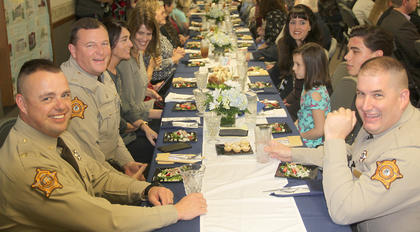 A sell-out crowd was on hand for the awards banquet. The meal was prepared by 13 different local restaurants and caterers and included a dessert bar of several delectables. Pictured are several members of the Harrison County Sheriff's Department and their families. On the left is Deputy Robert Peak, Sheriff Shain Stephens, Rebecca Stephens and Christy Barnes. On the right is honoree Deputy Nathan Gasser and his family, son Addison, daughter Kate and wife Megan.