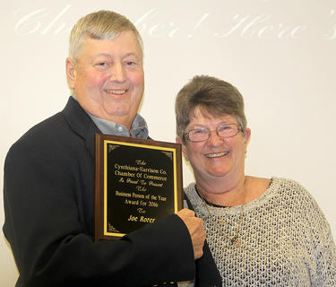 Businessperson of the Year Trudy Kimmel, on the right, presented Joe Rorer with the 2016 Chamber Businessperson of the Year award. It is the second time that Rorer has received the award.