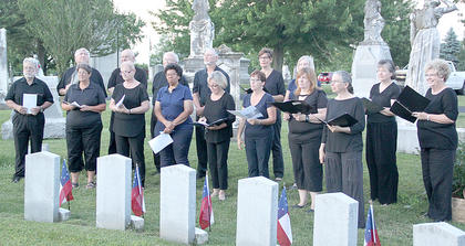 "The Licking Valley Singers at the cemetery performing ""The Blue and the Gray."""