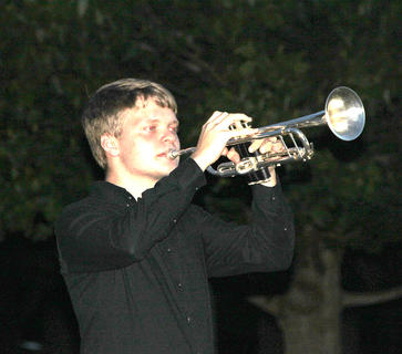 HCHS trumpeter Parker Roark played Taps at the luminary ceremony
