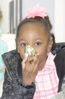 Several children got together, with their parents at Clifton Village to exchange Easter eggs filled with goodies, and then handed them out to the residents.