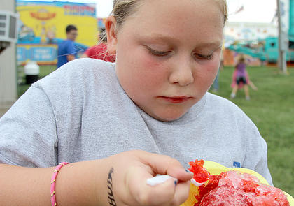 Kloe Bell enjoyed the snow cones from the midway.